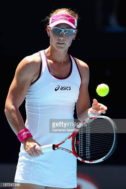Samantha Stosur of Australia waits to serve in her first round match against Sorana Cirstea of Romania during day two of the 2012 Australian Open at...