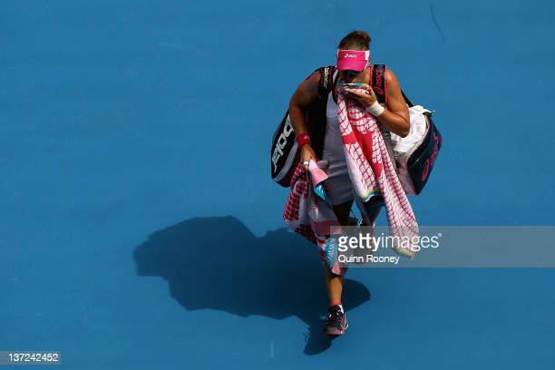Samantha Stosur of Australia walks off Rod Laver Arena after losing her first round match against Sorana Cirstea of Romania during day two of the...
