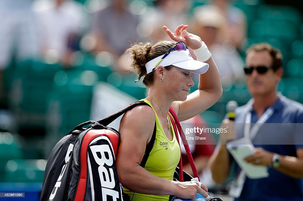 Samantha Stosur of Australia walks off the court after losing to Naomi Osaka of Japan during Day 1 of the Bank of the West Classic at the Taube Family Tennis Stadium on July 28, 2014 in Stanford, California.