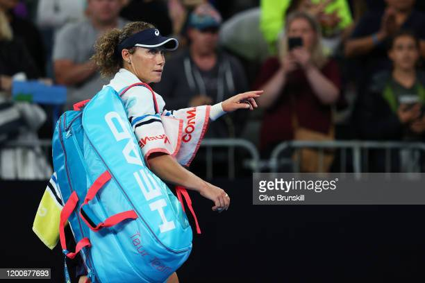Samantha Stosur of Australia waves to the crowd after losing her Women's Singles first round match against Catherine McNally of the United States of...