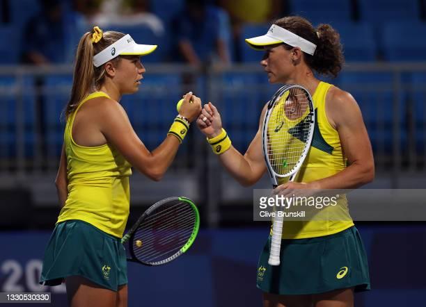Samantha Stosur of Team Australia and Ellen Perez of Team Australia during their Women's Doubles First Round match against Anastasija Sevastova of...