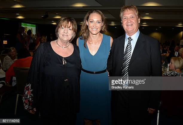 Samantha Stosur poses for a photo with her parents during the Fed Cup Official Dinner on April 14 2016 in Brisbane Australia