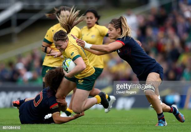 Samantha Treherne of Australia is tackled by Caroline Drouin and Marjorie Mayans of France during the Women's Rugby World Cup 2017 match between...