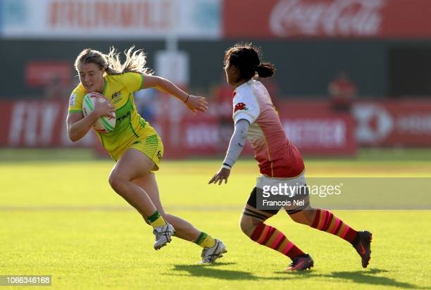 Samantha Treherne of Australia runs with the ball on day one of the Emirates Dubai Rugby Sevens HSBC World Rugby Sevens Series at The Sevens Stadium...