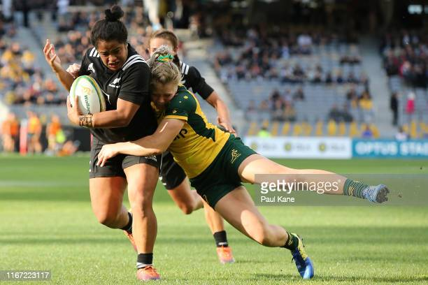 Samantha Treherne of Australia tackles Ayesha Leti I'iga of New Zealand during the Women's Test Match between the Australian Wallaroos and the New...