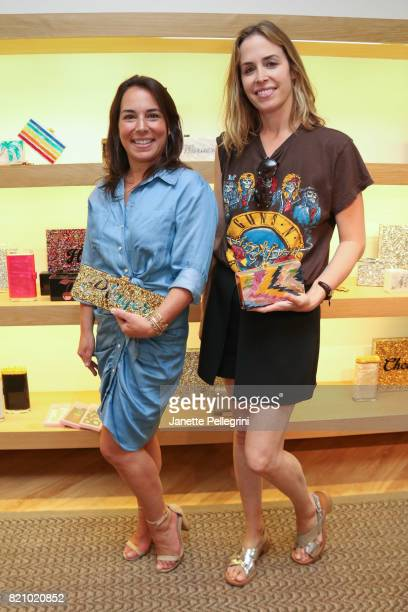 Samantha Yanks and Brett Heyman attend an Edie Parker PopUp at Intermix hosted by EditorinChief Samantha Yanks and Designer Brett Heyman on July 22...