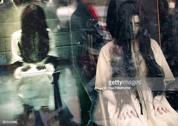 """Samara from """"The Ring Two"""" stares out at pedestrians from a window during a promotion at the Virgin Mega Store Union Square March 17, 2005 in New..."""