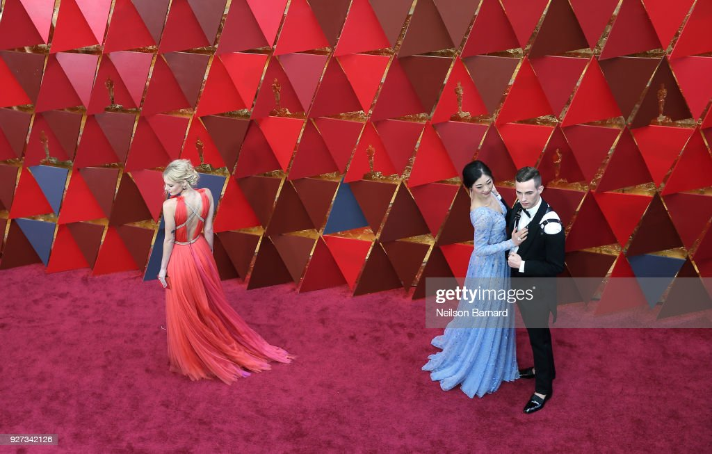 Samara Weaving, Mirai Nagasu and Adam Rippon attend the 90th Annual Academy Awards at Hollywood & Highland Center on March 4, 2018 in Hollywood, California.