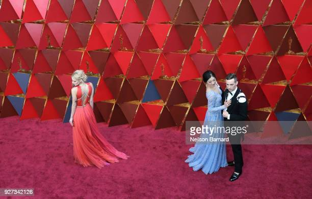 Samara Weaving Mirai Nagasu and Adam Rippon attend the 90th Annual Academy Awards at Hollywood Highland Center on March 4 2018 in Hollywood California