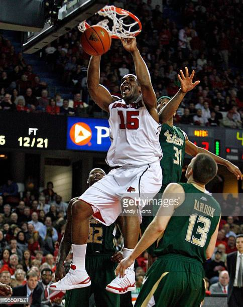 Samardo Samuels of the Louisville Cardinals dunks the ball against Jarrid Famous and Ryan Kardok of the South Florida Bulls during the Big East...