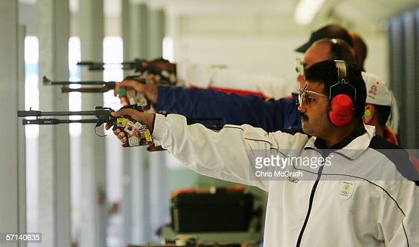 Samaresh Jung of India takes aim during the Men's 50m pistol Final at the Melbourne International Shooting Club during day six of the Melbourne 2006...