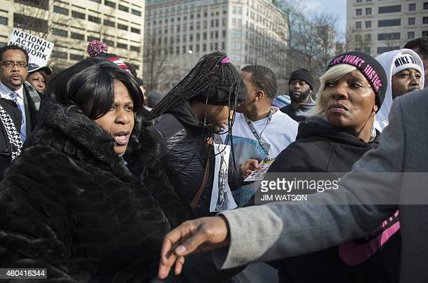 Samaria Rice mother of Tamir Rice who was shot and killed by a Cleveland police officer marches through the crowd during the Justice For All march in...