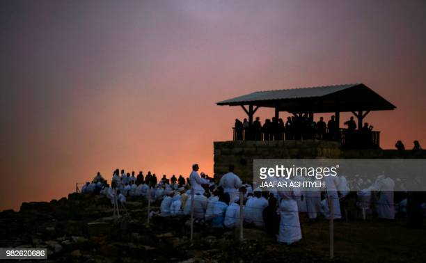 Samaritan worshipers gather at dawn on top of Mount Gerizim near the northern West Bank city of Nablus on June 24, 2018 during celebrations of...