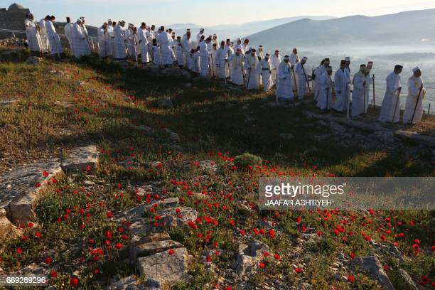 Samaritan worshipers take part in a Passover ceremony at Mount Gerizim near the northern West Bank city of Nablus early on April 17 2017 The...
