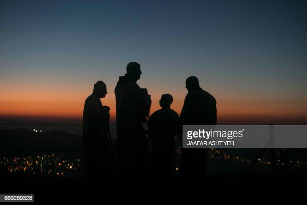 TOPSHOT Samaritan worshipers take part in a Passover ceremony at Mount Gerizim near the northern West Bank city of Nablus early on April 17 2017 The...