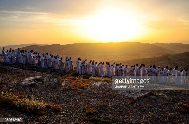 Samaritan worshippers arrive to take part in a Passover ceremony on top of Mount Gerizim, near the northern West Bank city of Nablus, on May 2, 2021....