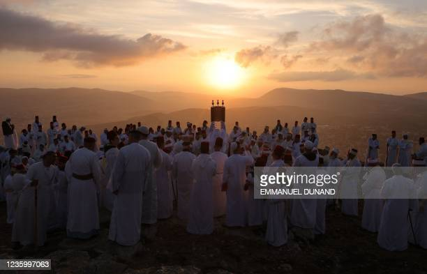 Samaritan worshippers hold a Torah scroll during a traditional pilgrimage marking the holiday of Sukkot, or Feast of Tabernacles, on top of Mount...