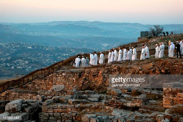 Samaritans gather to pray on top of Mount Gerizim near the northern West Bank city of Nablus as they celebrate the Shavuot festival at dawn, on June...