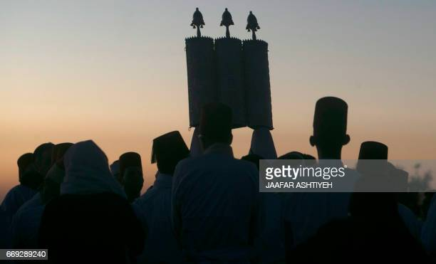 Samaritans pray during a Passover ceremony at Mount Gerizim near the northern West Bank city of Nablus early on April 17 2017 The Samaritans practice...