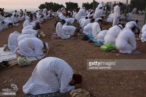Samaritans pray on Mount Gerizim near the northern West Bank city of Nablus on June 24 2012 to mark Shavuot festival which is giving of the Torah at...