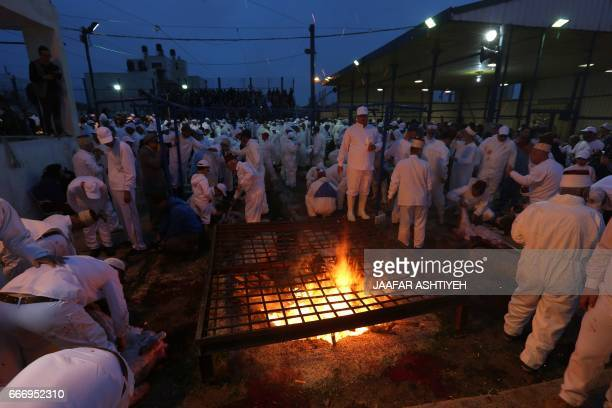 Samaritans take part in the traditional Passover sacrifice ceremony where sheep and goats are slaughtered at Mount Gerizim near the northern West...