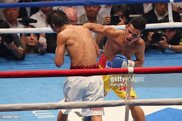 Samartlek Kokietgym of Thailand punches Naoya Inoue of Japan during the WBC light flyweight title bout between Naoya Inoue of Japan and Samartlek...