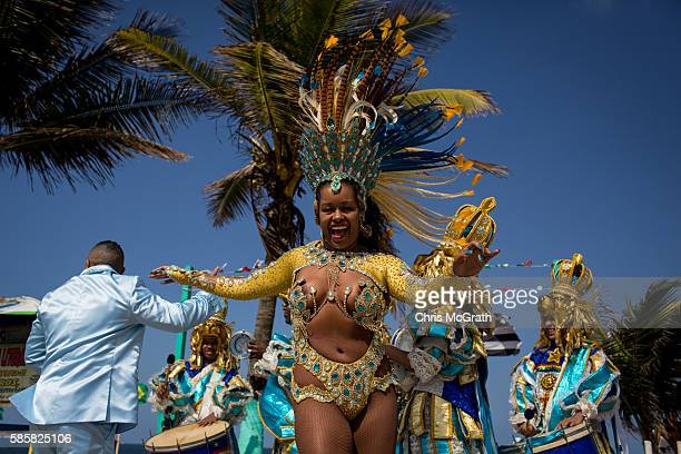 A samba dance group perform on the street while waiting for the arrival of the Olympic torch ahead of the Rio 2016 Olympic Games on August 4 2016 in...