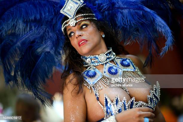 A samba dancer participates in the annual Carnival of Cultures inBerlin Germany 19May 2013 The colourful and loud procession moves through the...