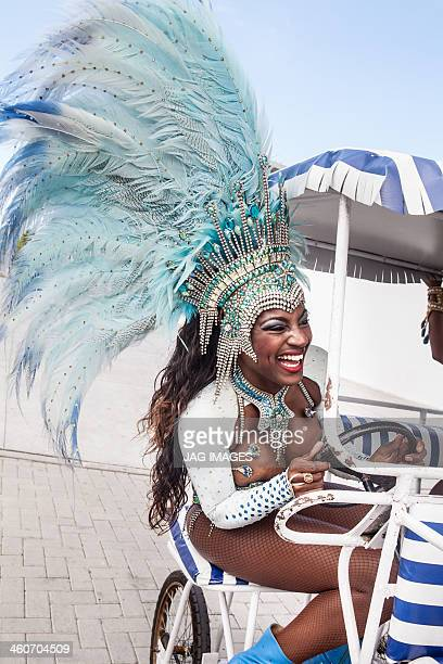 samba dancer riding cart, rio de janeiro, brazil - headwear stock pictures, royalty-free photos & images