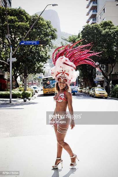 Samba dancer walking in full costume in Rio de Janeiro