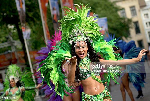 Samba dancers perform during a 'passacaglia' performance prior to the start of the FIVB Beach Volleyball World Championships on June 26 2015 in The...