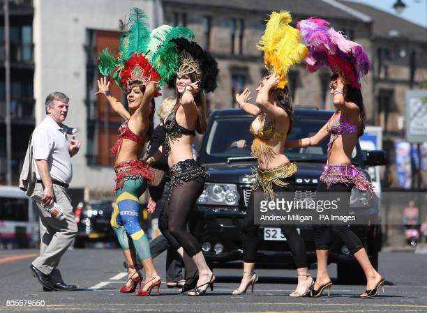 Samba dancers Thraissa Luna Fiona Hay Gillian Harkness and Georgina Anderson from dance troupe Eletricat stop traffic during a photocall in in...