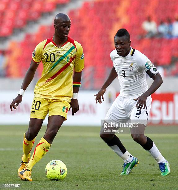 Samba Diakite of Mali and Asamoah Gyan of Ghana during the 2013 African Cup of Nations match between Mali and Ghana at Nelson Mandela Bay Stadium on...