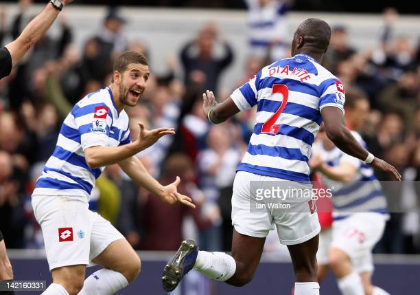 Samba Diakite of Queens Park Rangers celebrates scoring his side's second goal with team mate Adel Taarabt during the Barclays Premier League match...