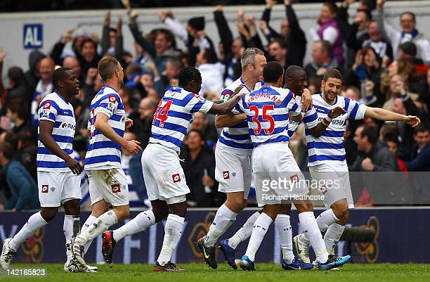 Samba Diakite of Queens Park Rangers celebrates scoring his side's second goal with team mates during the Barclays Premier League match between...