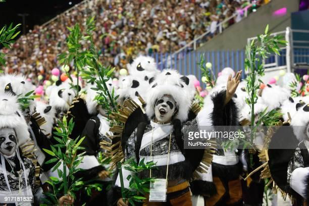 Samba school dancers perform at the carnival parade in Sapucai Sambadrome in Rio de Janeiro Brazil on January 12 2018