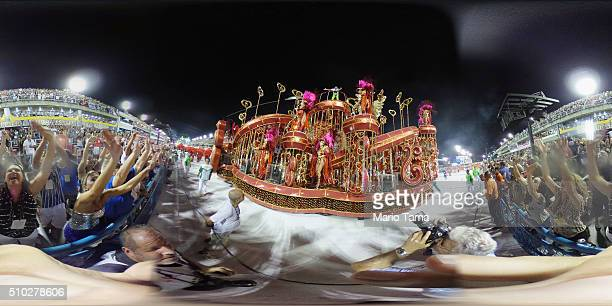 Samba school revelers parade as onlookers watch in the Sambodrome at the Champion's Parade on February 13, 2016 in Rio de Janeiro, Brazil....