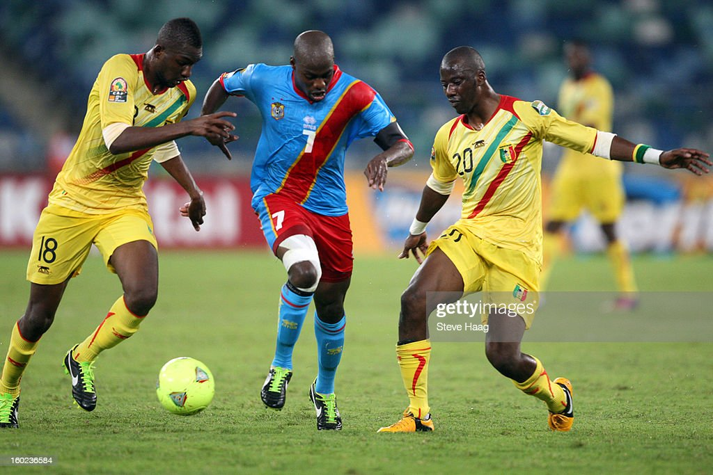 Samba Sow of Mali looks to tackle Youssouf Mulumbu of DR Congo with the help of Samba Diakite of Mali during the 2013 African Cup of Nations match between Congo DR and Mali at Moses Mahbida Stadium on January 28, 2013 in Durban, South Africa.