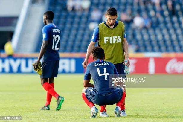 Sambou Sissoko of France Boubacar Kamara of France Nabil Alioui of France look dejected during the 2019 FIFA U20 World Cup Round of 16 match between...