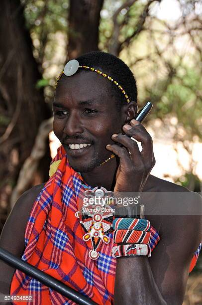 Samburu warrior dressed in traditional clothes talking on a mobile phone in northern Kenya The mobile revolution has transformed the lives of Kenyans...