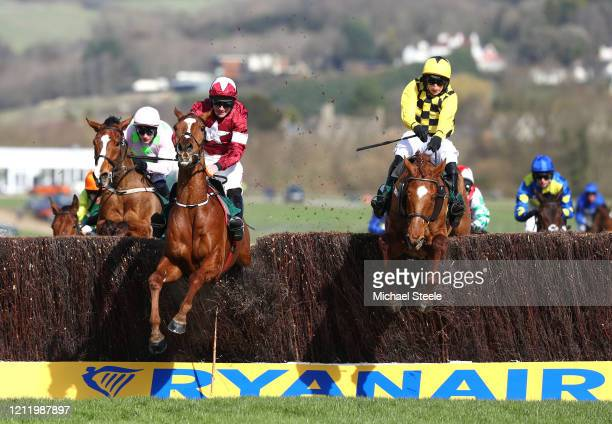 Samcro ridden by Davy Russell and Melon ridden by P W Mullins jump the second last fence during the Marsh Novices' Chase at Cheltenham Racecourse on...