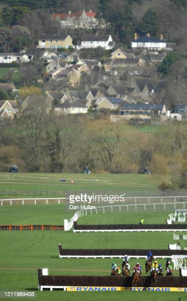 Samcro ridden by Davy Russell and Melon ridden by P W Mullins jump the last fence during the Marsh Novices' Chase at Cheltenham Racecourse on March...