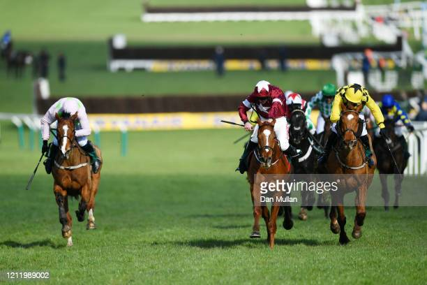 Samcro ridden by Davy Russell on their way to winning alongside Melon ridden by P W Mullins during the Marsh Novices' Chase at Cheltenham Racecourse...