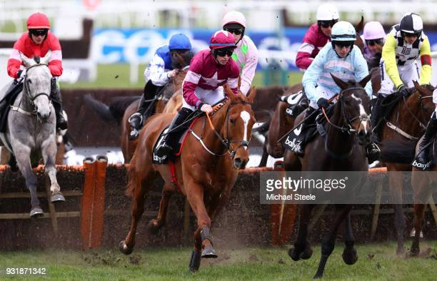 Samcro ridden by Jack Kennedy on the way to wiining Ballymore Novices' Hurdle during Cheltenham Festival Ladies Day at Cheltenham Racecourse on March...