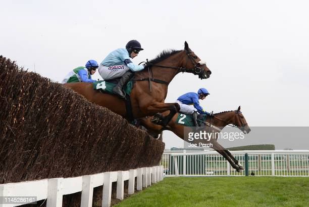 Same Circus ridden by Henry Brooke and Cabaret Queen ridden by Harry Skelton during The JRL Group Mares' Handicap Steeple Chase at Cheltenham...
