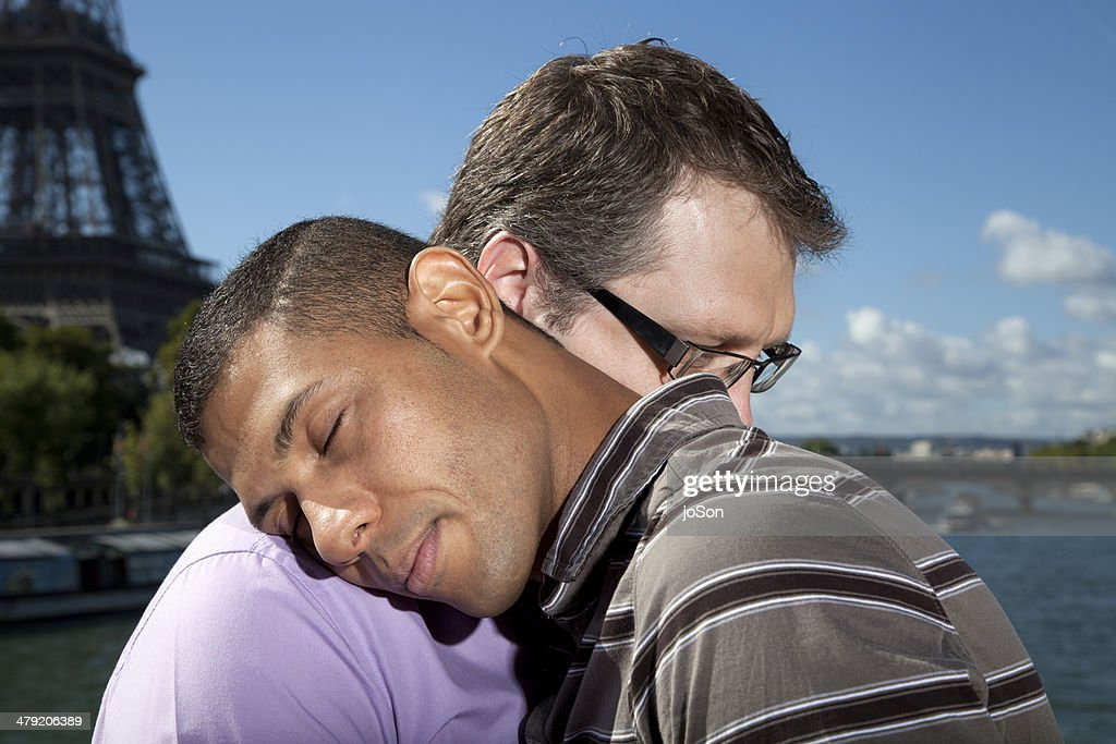 Same sex couple embracing, Paris : Stock Photo