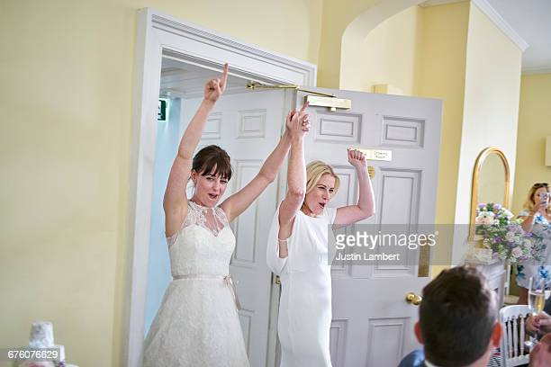 Same sex couple entering room getting married