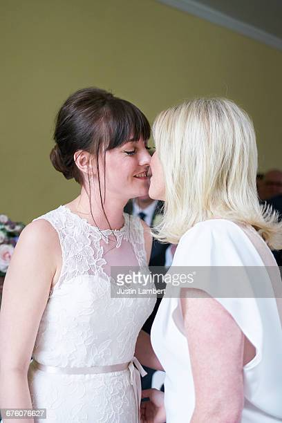 Same sex couple kissing getting married