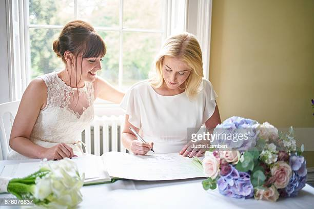 Same sex couple signing marriage register