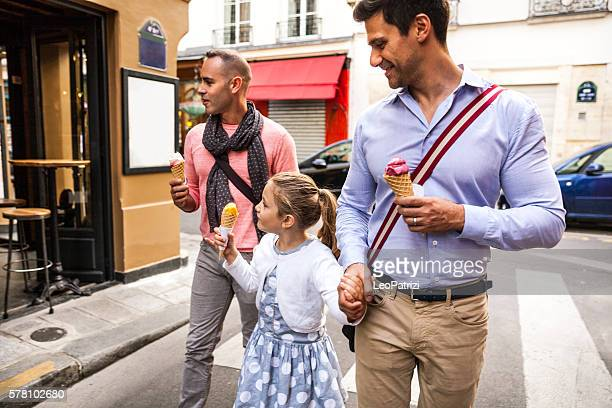 Same sex family spending a day outdoor in Paris downtown